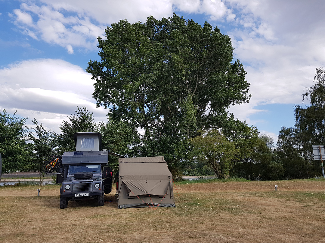 landrover campervan with oz tent