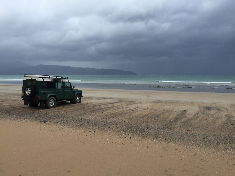 land rover campervan on beach